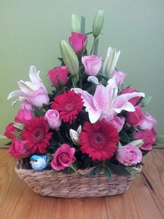 A Floral basket filled with lovely gerbera, tulips, and roses that give the sweetest memory in your event Basket Flower Arrangements, Altar Flowers, Artificial Floral Arrangements, Church Flowers, Beautiful Flower Arrangements, Beautiful Flowers, Cemetery Flowers, Arte Floral, Bouquets
