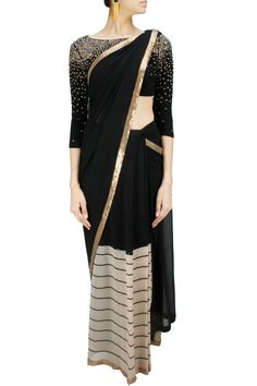 Black silk and striped georgette sari with sequin embellished blouse. BY NAMRATA JOSHIPURA. Shop now at: www.perniaspopups... #perniaspopupshop #designer #stunning #fashion #style #beautiful #happyshopping #love #updates