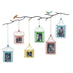 Simply the most charming way to showcase your family photos! This wall-mounted photo decor features six brightly colored birdcage frames that hang from a branch where two pretty birds are perched. Birdcage Photo Frame Decor  by Rustica House. #myRustica