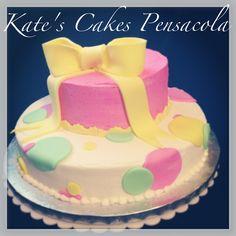 Fondant bow and polka dot cake.  Kate's cakes Pensacola FL