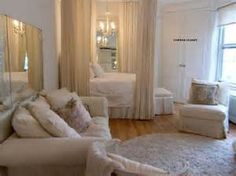 Small Apartment Decorating - for your studio apartment. Curtains around the bed. mirrors.