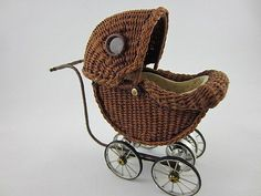 The carriage hood is hinged, closing over the main body of the pram. The inside basinet is leather lined. The metal frame and wheels, including the spokes, are all hand made. This piece measures (HxLxW). Dollhouse Accessories, Doll Accessories, Victorian Toys, Dolls Prams, Old Dolls, Toys Shop, Antique Toys, Miniature Dolls, Vintage Dolls