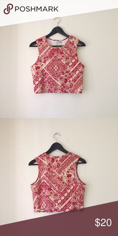 Red Floral Print Sleeveless Crop Top A swirling, vintage-inspired floral print adds feminine charm to a cropped tank that pairs beautifully with high waisted bottoms  •Size L  •New without tag  •NO TRADES/HOLDS Wayf Tops Crop Tops
