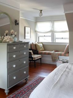 What's better than a cozy bedroom window seat? See more decorating ideas: http://www.bhg.com/decorating/small-spaces/homes/solutions-to-make-a-small-home-livable/  This is what we need to do on the third floor!