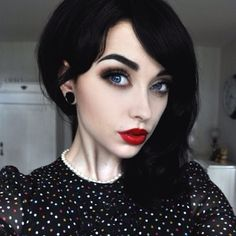 Absolutely Gorgeous Retro Pinup Goth Look Jet Black Soft Curled Hair Porcelain Skin Defined Brows Above Smoky Eyes And Candy Le Red Lips Manic Panic