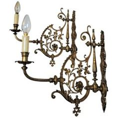 View this item and discover similar for sale at - French Art Nouveau pair of bronze and brass wall sconces richly decorated with floral motifs with new ecru cotton shades. One bulb socket Measures: Bronze Wall Sconce, Brass Mirror, Wall Sconces, Vintage Wall Lights, Contemporary Lamps, French Art, Floral Motif, Glass Shades, Cool Furniture