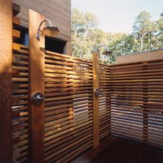 Outdoor Shower, not sure if I like it so enclosed in wood though. Its nice to have the plant life around too