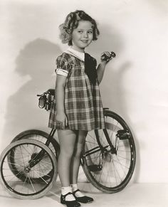 """Shirley Temple wearing same dress as when she sang, """"On the Good Ship Lollipop"""" from the film """"Bright Eyes."""" See this dress and more at the traveling exhibits, starting tomorrow, and at the July 14th auction event. http://www.theriaults.com"""