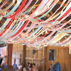 Grad Party Ceiling Decor - re-do with Red and Black.  I would LOVE to use strands of white lights too, Crystal!