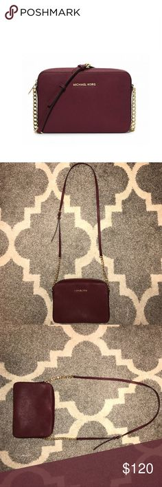 Jet Set Michael Kors cross body Burgundy color with gold accents. Worn maybe 3 times, in perfect condition! Perfect size to fit a large wallet, but not too clunky that it gets in the way! 10/10 recommend. KORS Michael Kors Bags Crossbody Bags