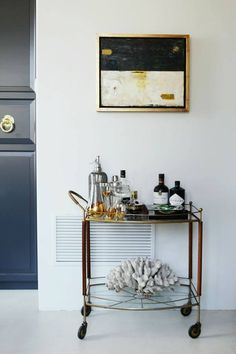 The bar cart looks cool but it's the art work above that I'm really liking.