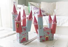 castle craft , cut slits in toilet paper rolls to attach to tissue paper base