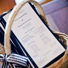White cardstock, printed with the details of the ceremony, was mounted on navy cardstock and accented with twine bows.