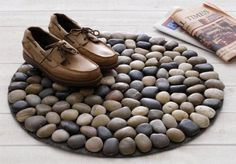 Here's the coolest doormat ever, and you can easily make one yourself! This is a great idea whether you need a mat foryour enclosed porch or bathroom. What's great about this mat is that water evaporates fast(depending on the materials that you use), preventing odor from building up. It's also easier to clean as opposed to fabric door mats -- simply wash it using a water hose and the dirt would be gone! Could your home use a river rock doormat? You'll need these materials: A Rol...