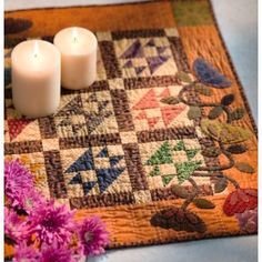 I love the applique in the corner of this sweet little quilt!  It's a Kim Diehl quilt.