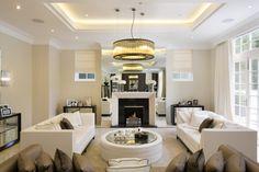 wohnzimmer-mit-kamin-ideen-bilder-gestaltung-modern-lichtleiste-integriert-decke