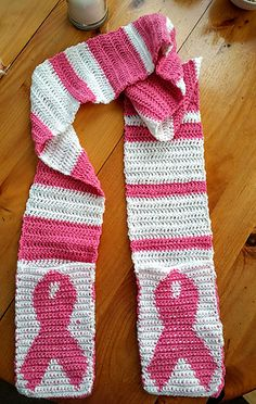 Breast Cancer Awareness scarf uses tapestry crochet to get the design in the pockets. The pockets are made first, then sewn onto the completed scarf. I used a random stripe generator (link in pattern) to come up with the scarf stripe pattern.
