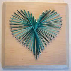 ***Our daughter made this last Xmas for her sister. She chose multicolored string, so it's reds and yellows and greens and blues. Super cute and very easy*** Nail & String Art Heart