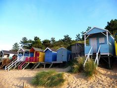 Row of bright beach houses. Beach Hut Shed, Beach Huts, Beach Cottages, Norfolk Beach, Norfolk Coast, British Beaches, British Seaside, Great Places, Beautiful Places