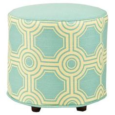 Cotton-upholstered ottoman with a geometric motif and exposed legs.   Product: OttomanConstruction Material: Cotton upholsteryColor: LagunaDimensions: 21 H x 21 DiameterCleaning and Care: Professional cleaning recommended