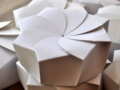 Sustainable Origami Food Box: the package resembles a bud that blooms into a flower when opened and only uses one piece of paperboard with no glue.