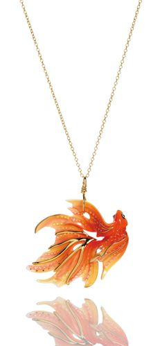 Goldfish pendant. 2 x 1 5/8 inches. Jewelry by Franz designer G.G. Santiago. Goldfish design Rhodium plated brass and sculptured porcelain pendant.