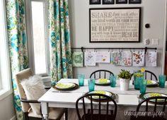 Beautiful bright airy kitchen with aqua P. Kaufmann Outdoor Silsila Pollside Fabric drapes