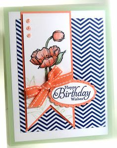 handmade birthday card from Me, My Stamps and I ,,, navy and white chevron background ... wide fishtail banner focal point with stamped flowers, three candy dots and a bow tied around it ... accents in rosy orange ... like this card!! ... Stampin' Up!
