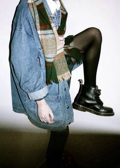 Oversized denim coat. Flannel scarf. Docs.