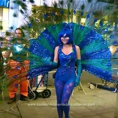 Homemade Peacock Costume: My inspiration for this Homemade Peacock Costume  was Victoria's Secret 2007 fashion show. Heidi Klum wore a giant silver snowflake, which opened up as