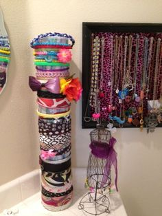 Girls Headband organizer rack holder. Three cans of large Instant Oatmeal containers, stacked and wrapped in gift wrap.