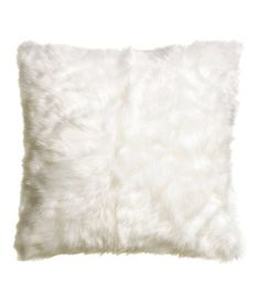 Cushion cover in faux fur with woven cotton fabric at back. Concealed zip. Size 16 x 16 in.