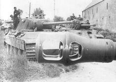 Looking through a muzzle cone, Panthers of 130th Tank Regiment training in Normandy.