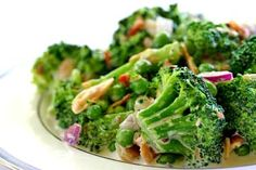 Broccoli salad, blanched fresh broccoli tossed with toasted almonds, bacon and peas, topped with a homemade honey vinegar dressing.  A favorite picnic salad.
