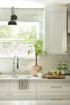 take the backsplash up the wall around the window - especially if its just that small space