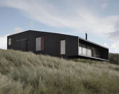 Image 1 of 11 from gallery of Vacation House in Henne / Mette Lange Architects. Photograph by Mette Lange, Anders Linnet Haus Am Hang, Architecture Résidentielle, Chinese Architecture, Timber Cladding, Architect House, House And Home Magazine, Black House, Prefab, Interior And Exterior
