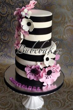 White and Black Cake with White and Pink Flowers