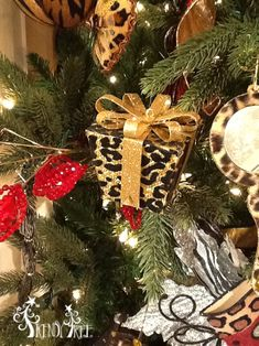 Flocked animal print package ornaments from the 2013 RAZ Christmas Catwalk Collection. See more of this collection at http://www.trendytree.com #trendytree #raz