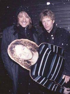 Jon Bon Jovi and Richie Sambora holding a cardboard cut-out of David Bryan
