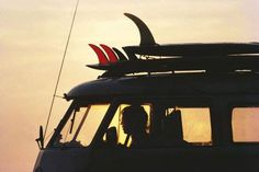 Surfboards and Van at Sunset
