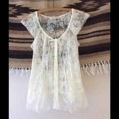 ABOUT TO DONATE - ✨🌵 Boho Lace Blouse 🌵✨ American Rag Size Medium Blouse. This floral lace blouse has ties in the front and back. Faux button up. In excellent condition. Super adorable girly boho look. Off white/ivory in color. American Rag Tops Blouses