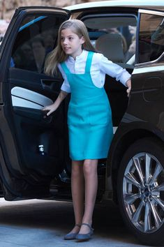 Infanta Sofia of Spain looked adorable in a turquoise pinafore dress teamed with a crisp white shirt, arrives at the Easter mass on April 1, 2018 in Palma de Mallorca, Spain