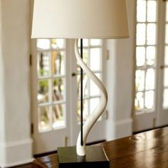 DIRA offers a contemporary, high fashion product line of home furnishings including pillows, framed textiles zulu bowls and baskets and high fashion candelabras African Design, Sconce Lighting, Natural Linen, Candelabra, Contemporary, Modern, Lamp Light, Home Furnishings, Sconces