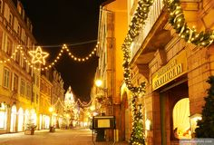 """Bartholdi"" restaurant witn Christmas lights at the city center by night. Colmar. Wine route. Haut-Rhin. Alsace. France"