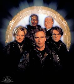 Stargate SG-1 - I've never seen this pic.  Must be an early one, judging by Daniel's hair and Teal'c's armor.