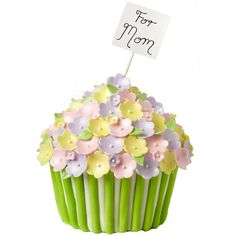 Bountiful Basket of Blooms Cake - Give Mom a cheery surprise on her special day with this Bountiful Basket of Blooms cake. Flowers are crafted using Ready-To-Use Rolled Fondant and flower cutters. A touch of shine is added with Pearl Dust!