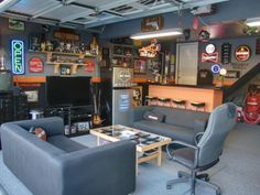 This Harley-themed hangout is the ultimate man cave. Gun-metal gray furniture, a bare-bones bar and plenty of neon signs give this space just enough rustic style and comfort for even the manliest of men. Design by HGTV fan Gunslinger