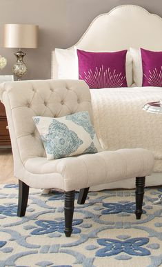 A perfect addition to your living room or den, this linen accent chair showcases diamond-tufted upholstery and turned legs. Get inspired at jossandmain.com