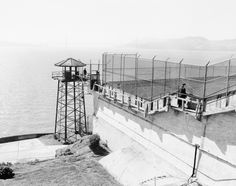 The No. 2 gun tower is pictured on the west side of Alcatraz in 1956. To the right, the recreation yard can be seen.