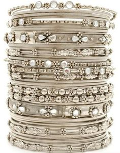 bangle bracelets with diamonds, rhinestones, pearls, charms, gemstones, jade, beaded or just plain polished metal....LOVE bangles.